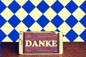 App mit Danke vor bayerischer Flagge