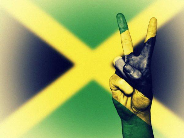 Jamaika Flagge mit Victory Zeichen