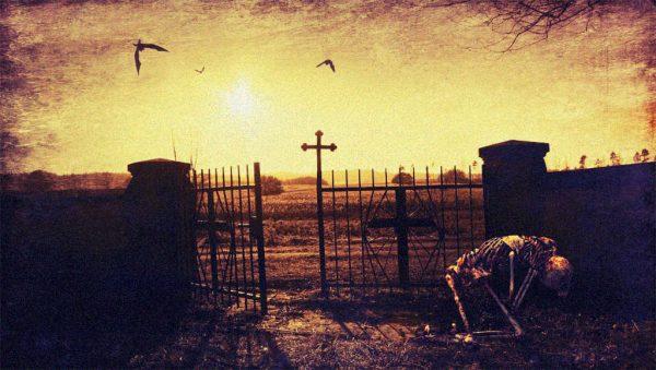ein Skelett kniet vor einem Friedhof